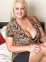 Big breasted British MILF playing in bed
